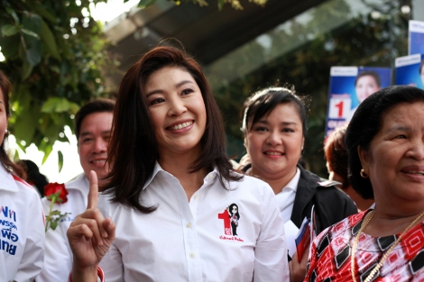 Yingluck Shinawatra poseed at camera with supporters during her campaigning in Bangkok. She is seen as a proxy of the former Prime Minister Thaksin Shinawatra, who was ousted by 2006 military coup.