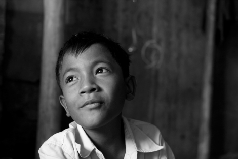 Chan Chao Loy (or 'Loy') is a 12 year old waste picker living in Siem Reap, Cambodia. Having both parents HIV positive, he has decided to pick recycling materials two years ago for helping his family. He also had been eager for buying school materials, bag and a new bicycle. He never skipped any single day for work, which starts from around 4 am to last about 3-4 hours if his school time is set for after noon. If his classes are set in the morning, he works after school. Loy on average earns 1000 riels (0.25 USD) per day, which has enabled him to buy some notebooks and his school bag, but bicycle. (Photo © Lee Yu Kyung 2013)