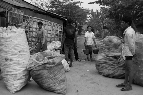 Chan Chao Loy (or 'Loy'), a 12 year old waste picker in Cambodia, has been living in slum area, where most of dwellers are waste pickers. (Photo © Lee Yu Kyung 2013)