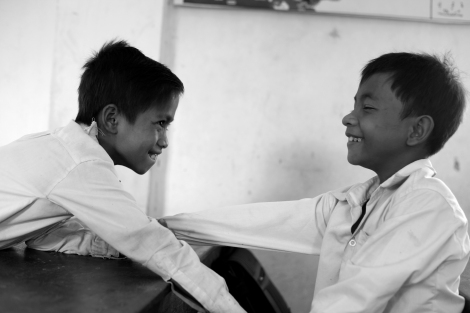 Chan Chao Loy (or 'Loy', right) and his friend are playing in their class room. Both are waste pickers. (Photo © Lee Yu Kyung 2013)