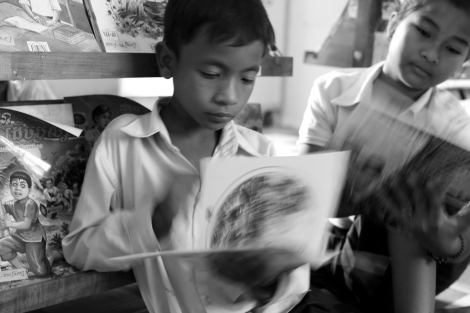 Chan Chao Loy (or 'Loy', left), a 12 year old waste picker is reading books in a school library which was donated by Room To Read. Being a fond of reading books and a bright child as well, his record is very high in a school. He is attending 4th grade as of 2013. (Photo © Lee Yu Kyung 2013)