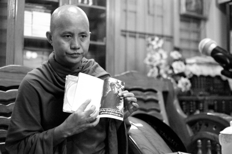 U Wirathu, the monk leading the Buddhist extremist 969 movement showed a picture of a Muslims man, who U Wirathu claimed, committed domestic violence against his Buddhist wife. He has advocated that Buddhist women should not married to Muslims men.  (Photo © Lee Yu Kyung 2013)