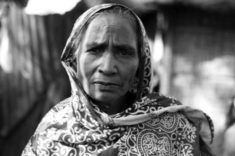 An elderly Rohingya woman living in slum area of Cox's Bazar district, Bangladesh. There are Rohingya dwellers who came to Bangladesh in 1978 when 250,000 Rohingya refugees influxed from Burma due to military operation as well as those who arrived in 2012, when the sectarian violence has turn to be a massacre of Rohingya community. (Photo © Lee Yu Kyung)