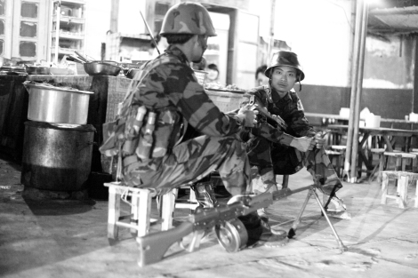 KIA soldiers at the local restaurant in Laiza, the rebel's capital near the Kachin (Northern Burma)-China border. (Photo © Lee Yu Kyung 2013)