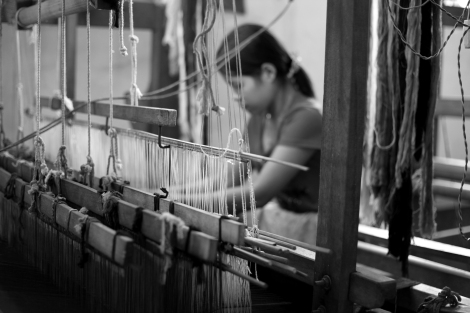 A Kachin woman is being trained at the weaving center in Laiza, the rebel's capital. The trainees include some victims of human trafficking, who did escape or return to the rebel's territory.