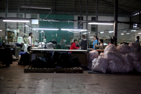 A Chinese-run factory near Canadia Industrial Park, which is located in south-west in Phnom Penh. The recent violent crackdown on garment workers in the city has raised serious questions of ethical  investment valuing human rights in developing countries, such as Cambodia. (Photo © Lee Yu Kyung)