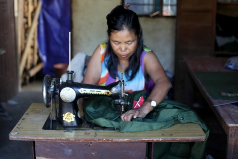 A woman tailor is making Kachin Independence Army or KIA's uniform in Laiza, the rebel's capital. KIA is military wing of Kachin Independence Organization (or KIO) which has been fighting for greater autonomy since 1961. (Photo © Lee Yu Kyung)