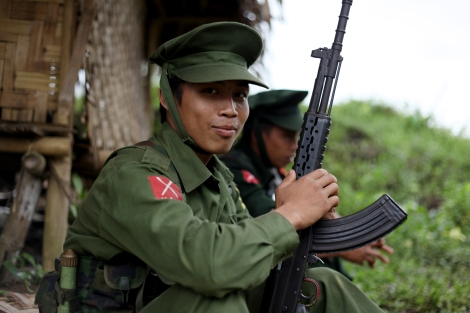 KIA soldiers near Laiza. Kachin Independence Army is military wing of Kachine Independence Organization which has been fighting for great autonomy since 1961. KIA has been engaging in battle with government troops since 2011 June as 14 years old ceasefire agreement broke down. (Photo © Lee Yu Kyung)