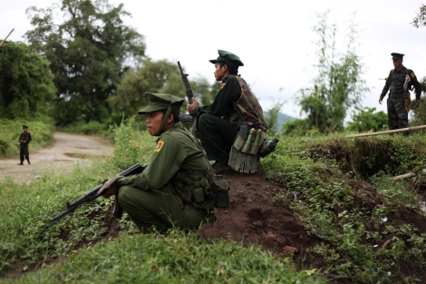 KIA soldiers near Laiza, the rebel's capital are waiting for Ethnic representatives who were coming from Myitkyna to attend Ethnic Armed Organization Conference late 2013. Kachin Independence Army is military wing of Kachine Independence Organization which has been fighting for great autonomy since 1961. KIA has been engaging in battle with government troops since 2011 June as 14 years old ceasefire agreement broke down. (Photo © Lee Yu Kyung)