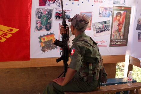 An ABSDF cadre sees pictures exhibited in the occasion of its 25th anniversary in Kachin State. . It has signed a ceasefire with the government. KIA accommodates a few other armed groups in Kachin state with whom they wage joint-operation against the government troops at times. (Photo © Lee Yu Kyung)