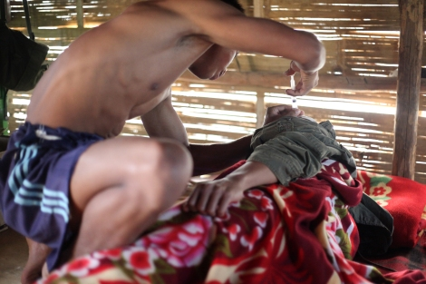 Arakan Army medic injects his sick comrade in the camp. The new and young rebel army was founded in 2009 after receiving military training from Kachin Army. Cadres of Arakan army are not shy to say they are fighting against Islamization as well as Burmanization. (Photo © Lee Yu Kyung)
