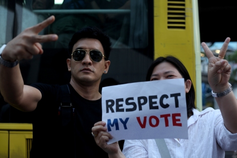 "Ake Ottagon (34) at 'Respect My Vote' campaign early this year. He was shouting ""Respect My Vote!"" at a press conference by Democrats - the party associated with conservatives and has a history of  boycotting election. Since his slogan has become campaign for democracy. (© Lee Yu Kyung 2014)"