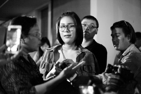Natchacha Khongudum is one of the student activists who've been active anti-coup protest. She's become well known after posing three fingers salute at the cinema, the gesture was invented from Hunger Game as a sing of resistance against totalitarian regime. (© Lee Yu Kyung 2014)