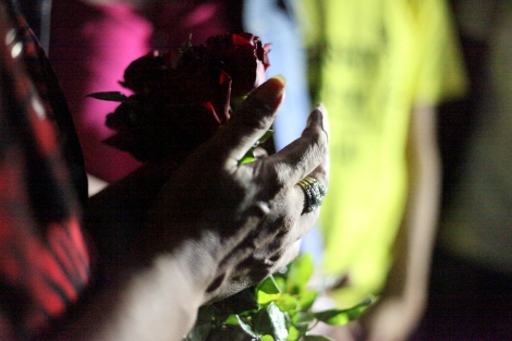 One of the participants holding rose to support for students, who were arrested days ago for 'three finger salute' at the cinema screening 'Hunger Game'. Three fingers salute has become a symbol of resistance against authoritarian rule in Thailand. And now it's banned. (Photo © Lee Yu Kyung 2014)