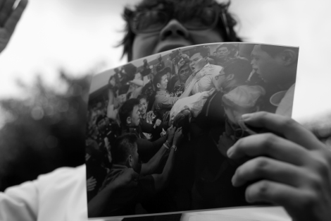 An anti-coup activist was holding a picture showing that plain clothes police attacked  peaceful protesters on May 22, one year anniversary of the latest coup. (© Lee Yu Kyung 2015)