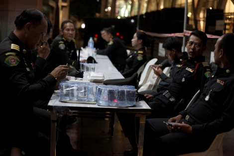 City police in Bangkok near the deadly blast scene. (© Lee Yu Kyung)