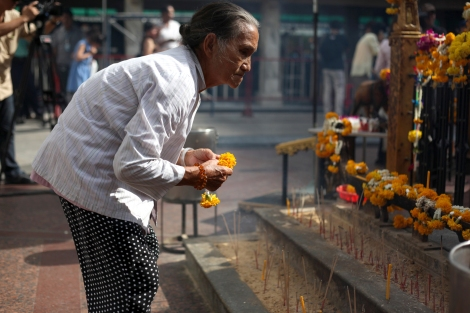 Gi Gwo Lian (70) is Myanmar citizen of Chinese origin. She came to Bangkok on August 17, the day of deadly bomb blast. 2 days later as Erawan Shrine reopened, she came to pray for victims. (© Lee Yu Kyung)