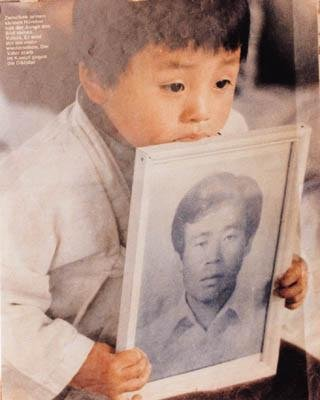 One of the symbolic pictures of the Gwangju Uprising in 1980. The boy holds portrait of his father, who got killed during the Uprising.